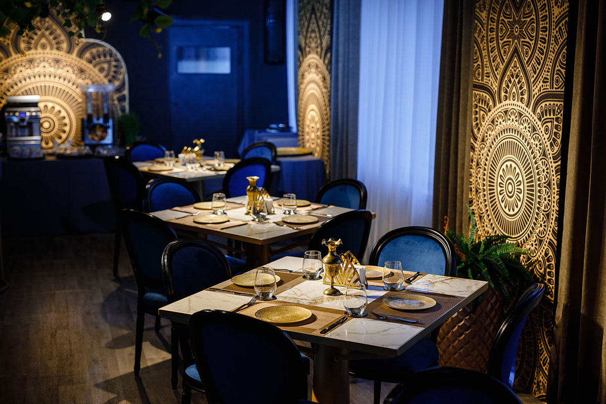Restaurant interior design with gold plates and blue chairs
