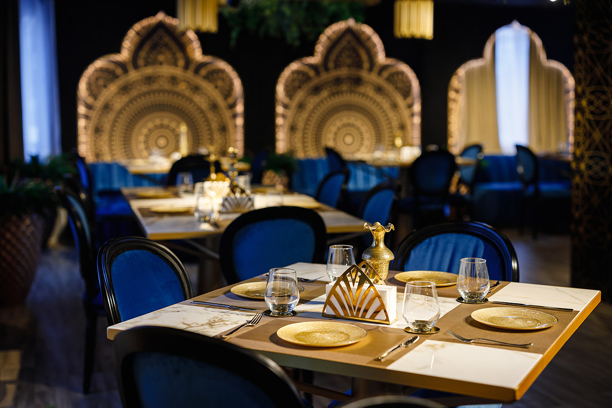 Architectural design in modern style for the restaurant in golden and blue shades